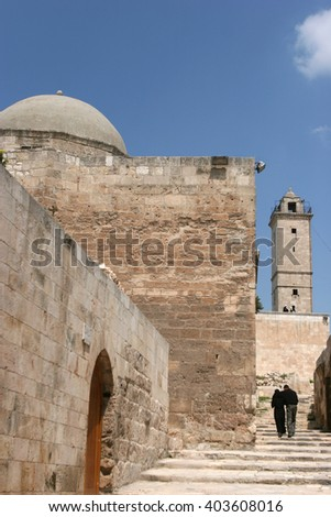 Citadel of Aleppo, a large medieval fortified palace in the centre of the old city of Aleppo, northern Syria