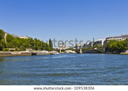 Cite Island and Cathedral Notre Dame de Paris. Cathedral Notre Dame de Paris � most famous Gothic, Roman Catholic cathedral (1163-1345) on the eastern half of the Cite Island. France, Europe. - stock photo