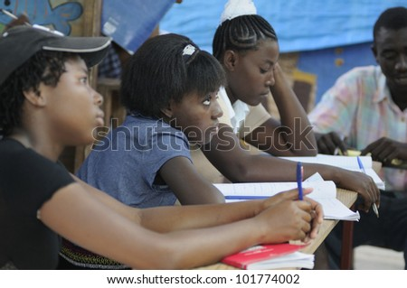 CITE SOLEIL- AUGUST 25:  Female students attending classes in a local community school in Cite Soleil- one of the poorest area in the Western Hemisphere on August 25 - stock photo