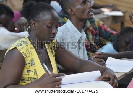 CITE SOLEIL- AUGUST 25:  Mature students learning english in a local community school in Cite Soleil- one of the poorest area in the Western Hemisphere on August 25 2010 in Cite Soleil, Haiti. - stock photo