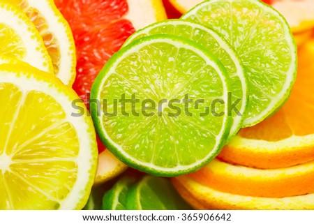 citrus background - lime, lemon, orange, grapefruit - stock photo