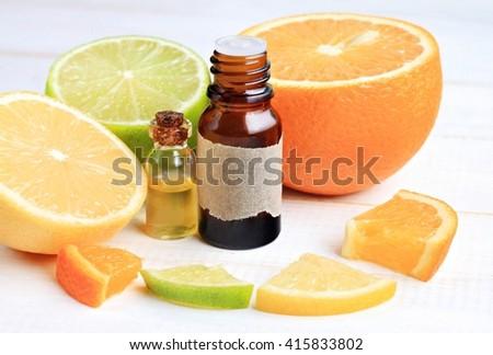 Citrus essential oils. Lemon, lime, orange, cosmetic use - stock photo