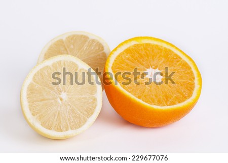 Citrus fresh fruit on white background. Ripe lemons and oranges.