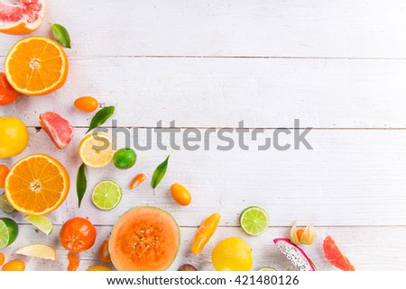 Citrus fresh fruits on a wooden table, close-up. - stock photo