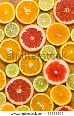 Citrus fruit background with sliced f oranges lemons lime tangerines and grapefruit as a symbol of healthy eating and immune system boost with natural vitamins.