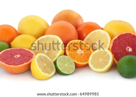 Citrus fruit collection with ruby red and yellow grapefruit, orange, lime and  lemons, whole and in halves, isolated over white background. - stock photo