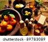 Citrus fruits and aromatherapy supplies - stock photo