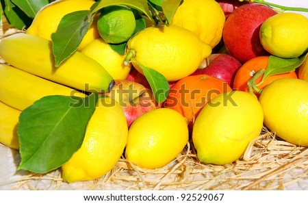 citrus fruits, banana and apples