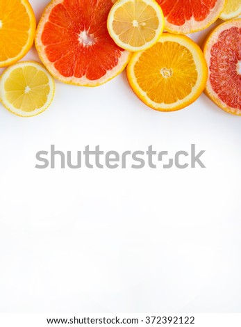 Citrus fruits. Oranges, grapefruits and lemons. Over white background with copy space