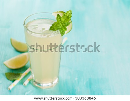 Citrus lemonade with lime and mint, selective focus - stock photo