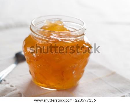 Citrus (orange)  jam with ginger  in glass jar, selective focus - stock photo