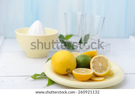 Citrus squeezer and fresh lemons being used to make fresh lemonade - stock photo