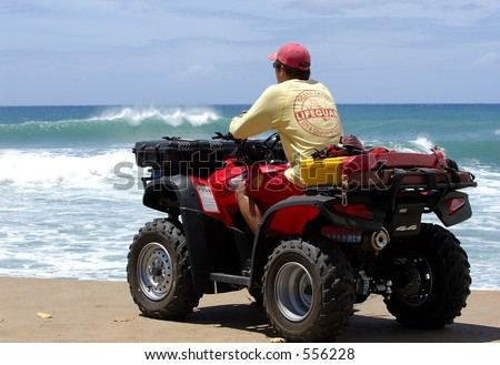 City and County of Honolulu Lifeguard watches the surf at Ala Moana Beach Park in Hawaii. - stock photo