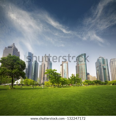 city and grass with blue sky