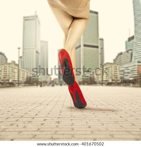 city and woman legs