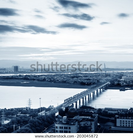 City at dusk, aerial view of the bridge.