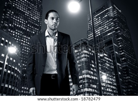 City banker standing by the city finance buildings - stock photo