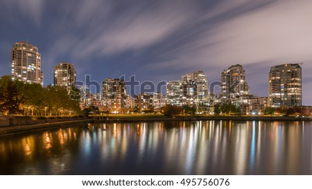 city building lights reflections with Fall season backgrounds