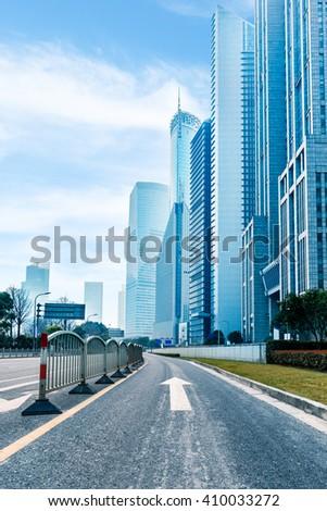 city,building,road under blue sky,shanghai china. - stock photo