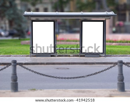 City bus stop with two publicity boards - stock photo