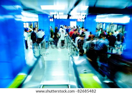 city business passenger at subway station at intentional motion blurred