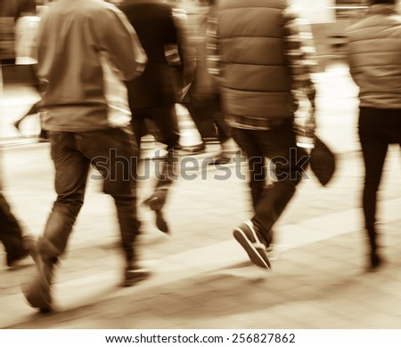 City business people walking in the commercial street, blurred motion background - stock photo