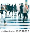 city business people walking in the lobby blur motion - stock photo