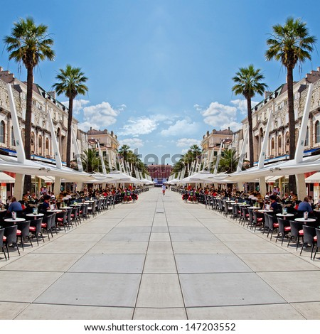 City Cafe Perspective View With Palms, Sunny Day and Blue Sky. Split. Croatia. - stock photo