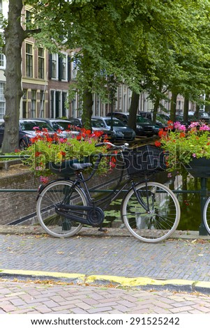 City center and bicycle parked on a bridge in the Amsterdam, Netherlands