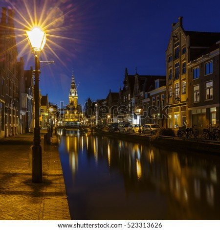 City center of Alkmaar Holland a canal and the tower of the Waag in the city of Alkmaar, The Netherlands.