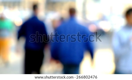 City commuters. Blurred image of workers going back home after work. Unrecognizable faces, bleached effect. - stock photo
