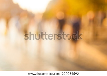 City commuters. High key blurred image of workers going back home after work. Unrecognizable faces, bleached effect. - stock photo