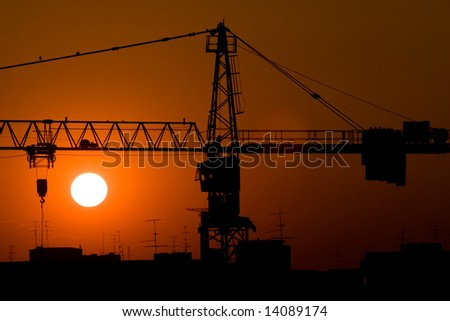 City construction crane in the sunset