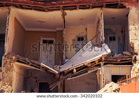 City destroyed building. the aftereffec of the disaster - stock photo