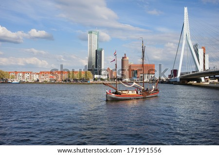 City downtown of Rotterdam river view, Erasmus Bridge on the right, South Holland, the Netherlands. - stock photo