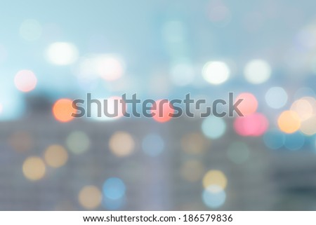 City fade light blur bokeh. Defocused abstract background. Vintage style. - stock photo