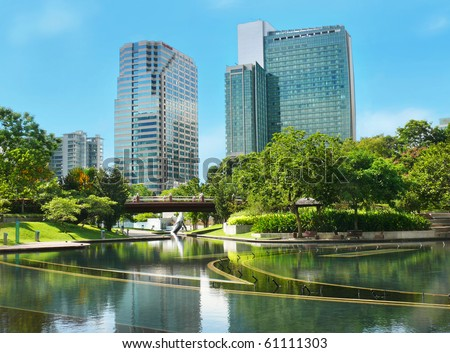 City gardens with skyscrapers - stock photo