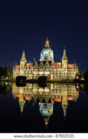 City Hall of Hannover, Germany by night with reflection in a lake