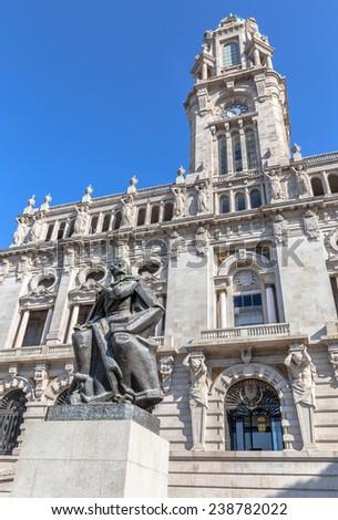 City hall of Porto with the statue of writer Almeida Garretton. - stock photo