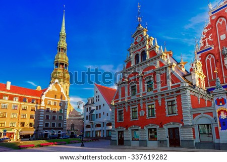 City Hall Square with House of the Blackheads and Saint Peter church in Old Town of Riga in the evening, Latvia - stock photo
