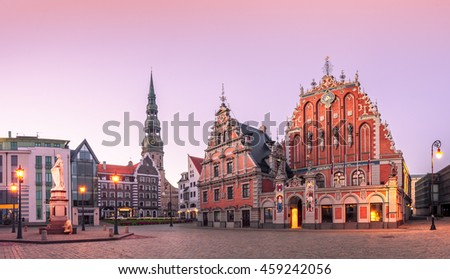 City Hall Square with House of the Blackheads and Saint Peter church in Riga Old Town During sunset time. - stock photo