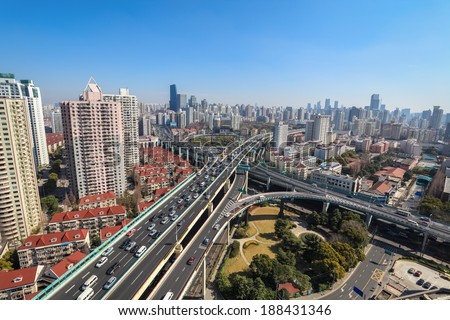 city highway junction ,interchange overpass on traffic rush hour in shanghai  - stock photo