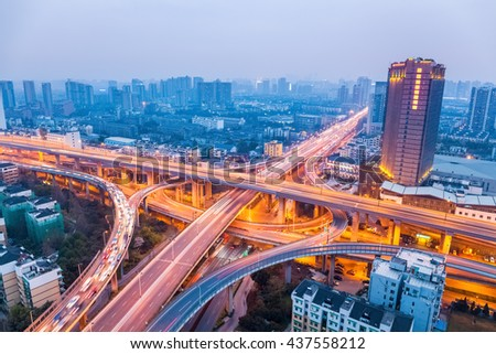 city highway overpass in hangzhou ,  bright lights and traffic.