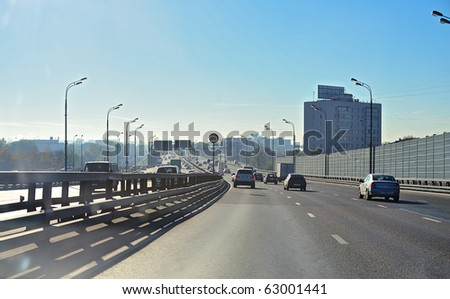 city highway with moving cars in bright  morning