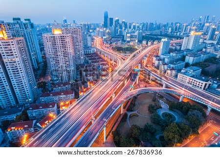 city interchange at nightfall in shanghai, modern transport infrastructure background - stock photo