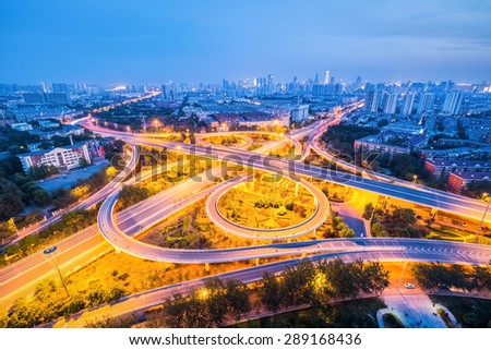 city interchange in night falls , road transport background - stock photo