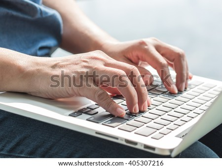 City lifestyle journalist blogger woman working on computer device typing texting in office indoor space Hand keyboard typing People w/ wifi cyber IT IOT IM PPC communication technology daily life seo - stock photo