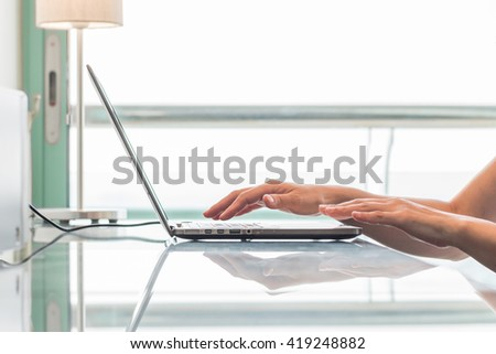 City lifestyle woman hands working on home office computer typing on laptop keyboard using IOT IT SEO wifi cyber internet online digital media technology pc device in urban aerial view environment - stock photo