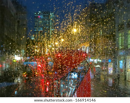 City lights from London bus in rainy night - stock photo