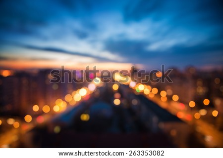 city lights in the evening blurring background - stock photo